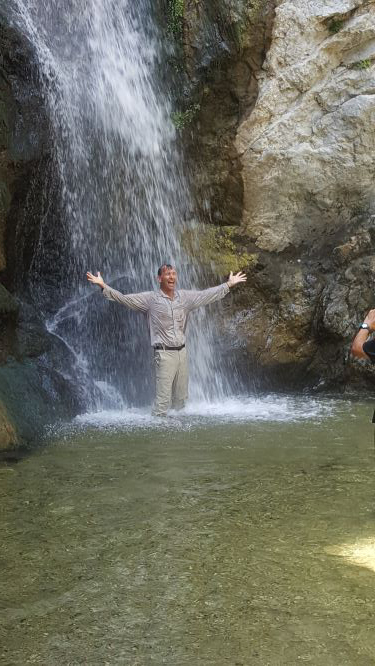 Dr. Adams under a waterfall at Eaton Falls Hiking Trail in Pasadena, CA